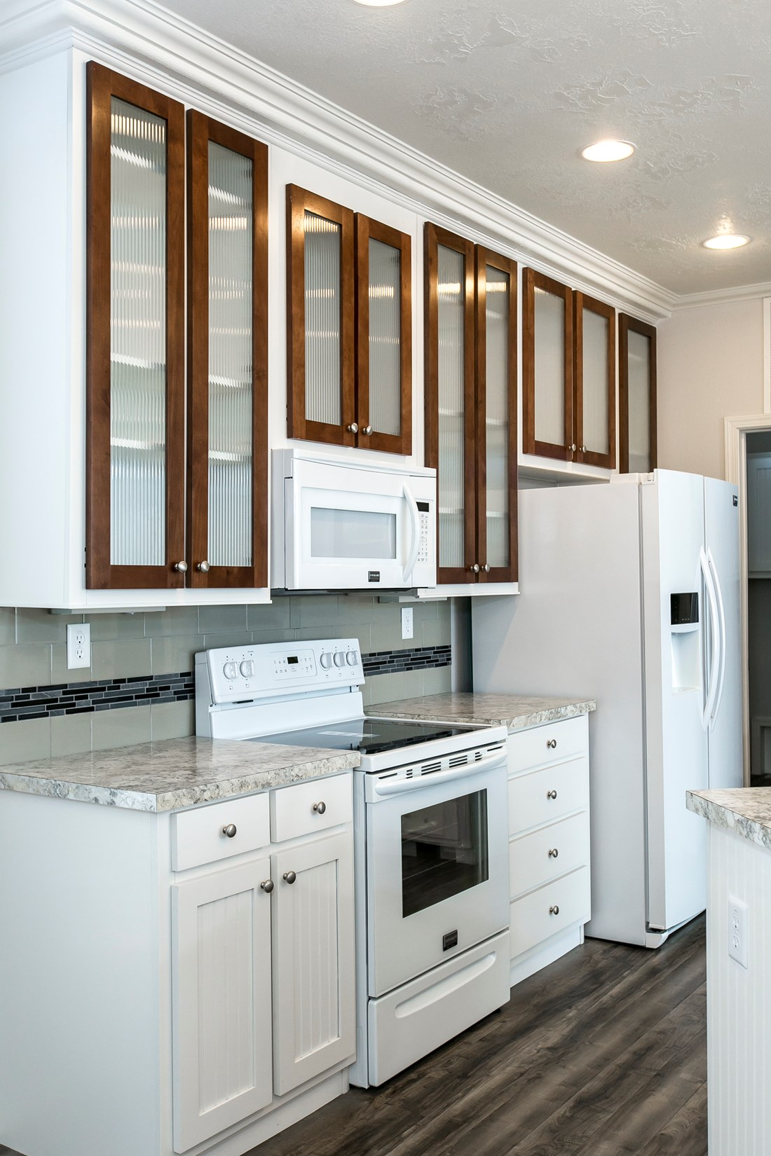 The ING681F EUCALYPTUS   (FULL) GW Kitchen. This Manufactured Mobile Home features 3 bedrooms and 2 baths.