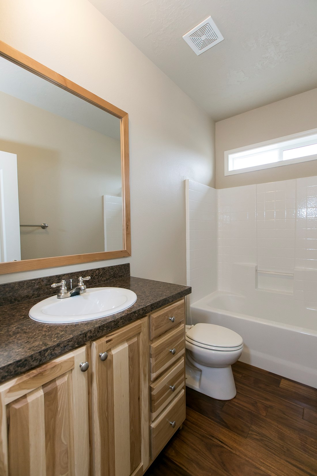 The THE SPRUCE Guest Bathroom. This Manufactured Mobile Home features 3 bedrooms and 2 baths.