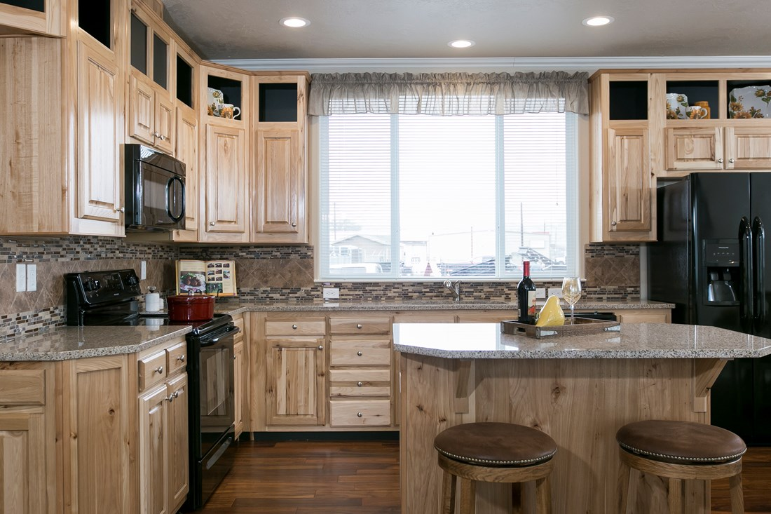 The THE SPRUCE Kitchen. This Manufactured Mobile Home features 3 bedrooms and 2 baths.