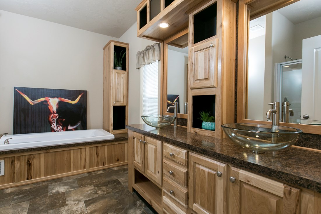 The THE SPRUCE Master Bathroom. This Manufactured Mobile Home features 3 bedrooms and 2 baths.